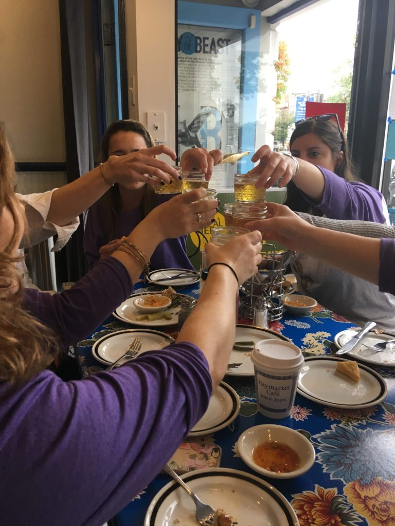 Private food tours group toast with hard cider