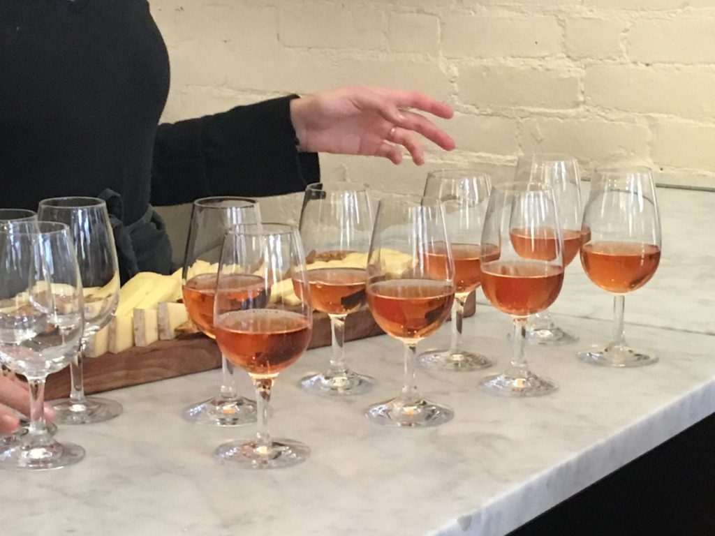 Samples of local red cider and cheese on food tours