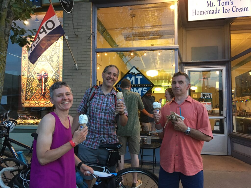 Woman and 2 men with bike ice cream stop on bike tour stop