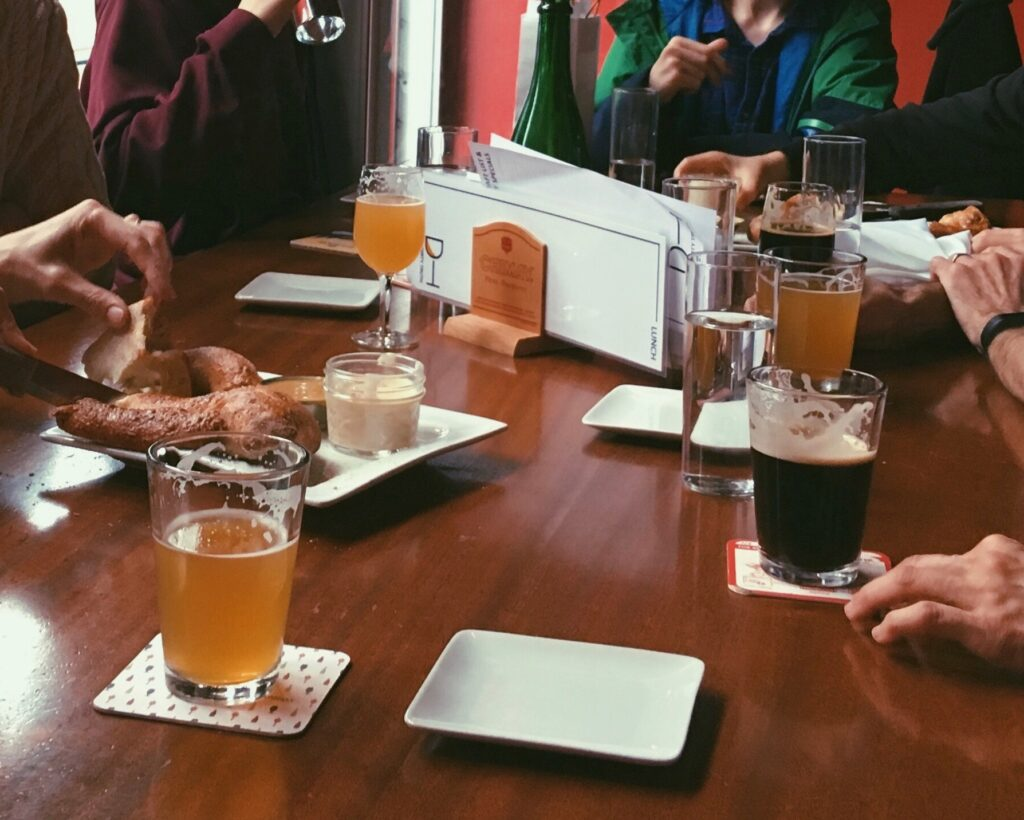 Craft brewery beers with soft pretzel on brewery tour