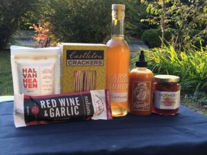 contents local gift box outdoors salami crackers sriacha jam cider drinksweet
